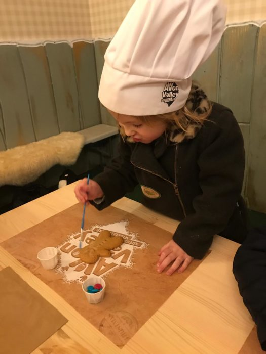 child making gingerbread