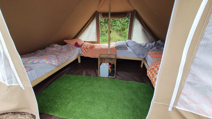 Single beds set up in the explorer tents