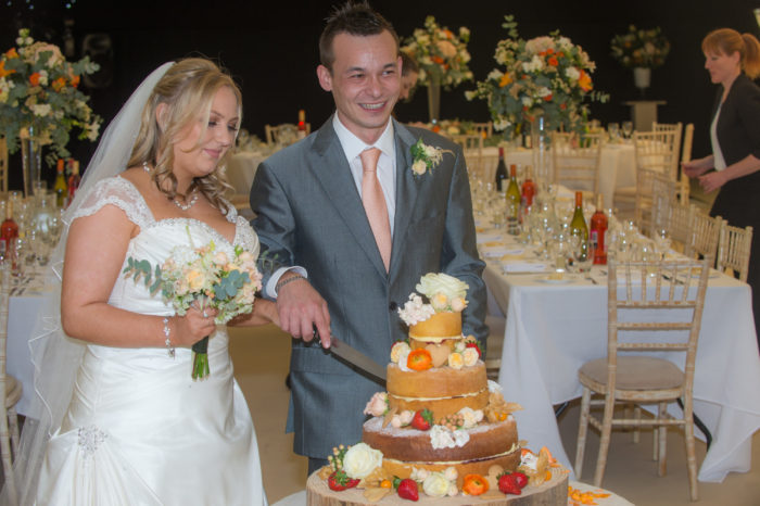 Cutting the wedding cake at Avon Valley