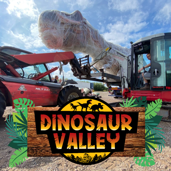 dinosaur valley logo with trex arriving at the park with a forklift truck